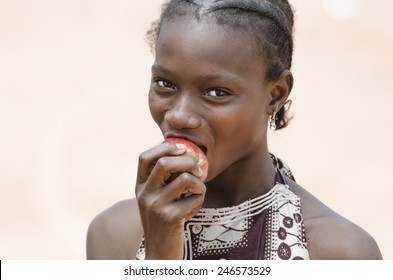 Health Symbol: Beautiful Young African Girl Biting A Healthy Apple
