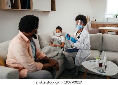 Health visitor, young boy and his father during home visit