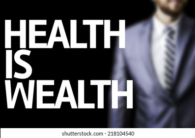 Health is Wealth written on a board with a business man on background