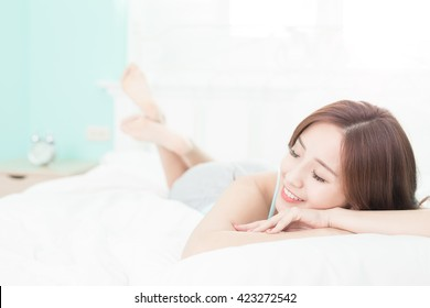 Health woman Smile feel carefree and she lying on the bed in the morning , asian girl