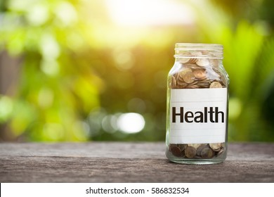 Health word with coin in glass jar,  concept siphons money and Health insurance.