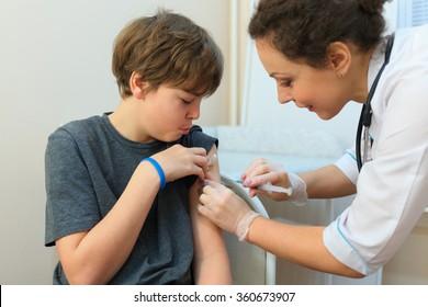 Health worker was injected drug in shoulder of boy in exam room