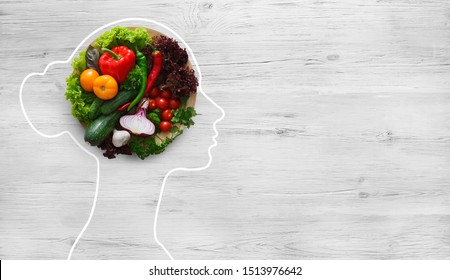 Health in your brain. Fresh vegetables in woman head symbolizing health nutrition on gray background, panorama, copy space - Shutterstock ID 1513976642