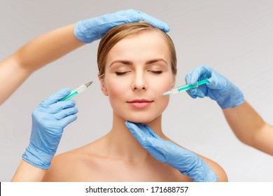 healthcare, beauty and medicine concept - beautiful woman face with closed eyes and beautician hands with syringe