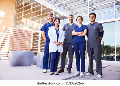 Healthcare colleagues standing outside hospital, full length
