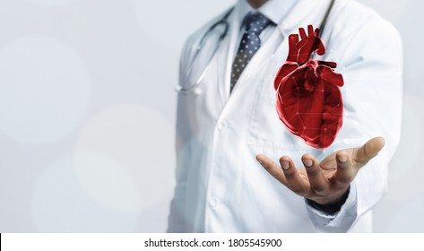 Healthcare Concept. Closeup of doctor in white coat holding virtual heart in open palm, copy space