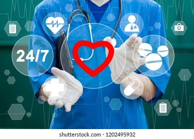 Healthcare concept. Doctor pushing button heart pulse healthcare network on internet panel medicine.