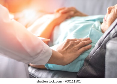 Healthcare concept of professional psychologist doctor consulting and comforting elderly patient in psychotherapy session or counsel diagnosis health.
