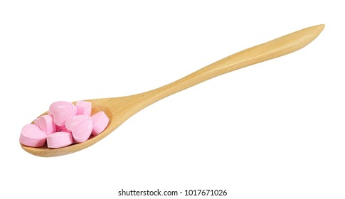 Healthcare Concept, Wooden Spoon Full with Pink Heart Shape of Vitamins Pill Isolated on A White Background.