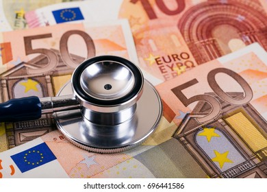 healthcare cost and insurance concept. stethoscope on euro money