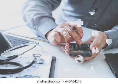 Healthcare costs and fees concept.Hand of smart doctor used a calculator for medical costs in modern hospital with VR icon diagram