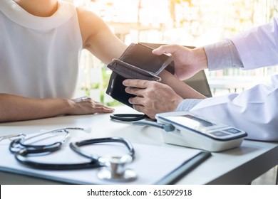 healthcare, hospital and medicine concept - doctor and patient measuring blood pressure.