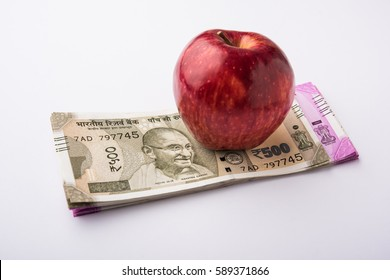 Healthcare in India - Concept of health and business showing Indian paper currency notes, Stethoscope, Pills, Calculator, Apple fruit and Stuffed Heart Toy. Selective focus