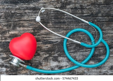 Healthcare insurance and world heart health day concept with red heart love with medical doctor physician's stethoscope