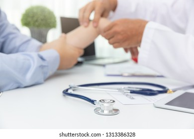 Healthcare and medical concept, Close up stethoscope with Doctor explain wrist pain symptoms and medical treatment to patient in hospital
