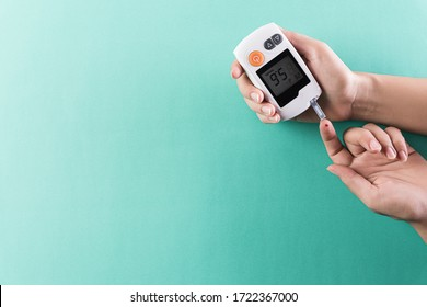 Healthcare and medical concept, The diabetic measures the level of glucose in the blood. World Diabetes day, 14 November.