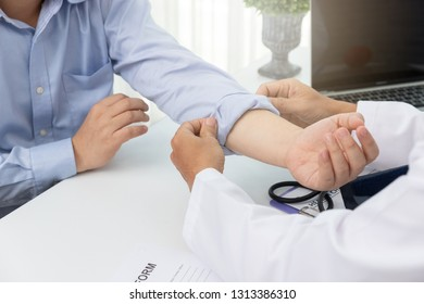 Healthcare and medical concept, Doctor checking patience's pulse by fingers in hospital.