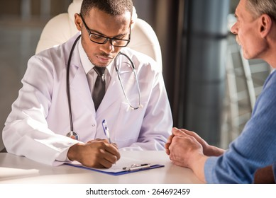 Healthcare and medical concept. Doctor talking to his male patient.
