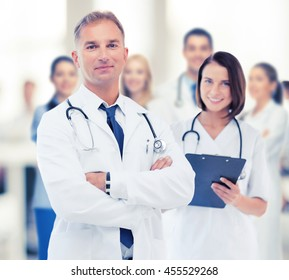 healthcare and medical concept - two doctors in hospital