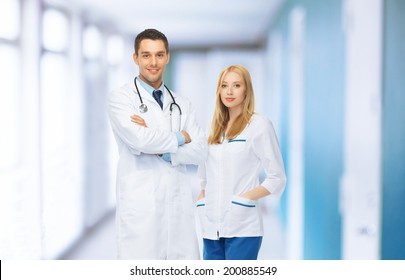 healthcare and medical concept - two young attractive doctors in medical facility