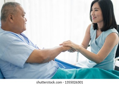Healthcare or medical concept : Young Asian woman visit her father or elder cousin while on the way to recovery during receiving a treatment in the hospital.