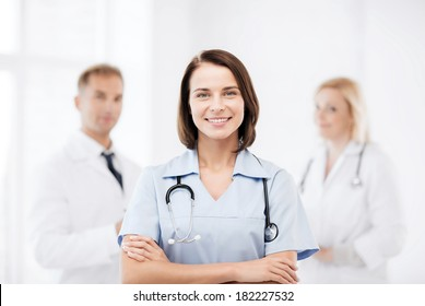 healthcare and medical concept - young female doctor with stethoscope