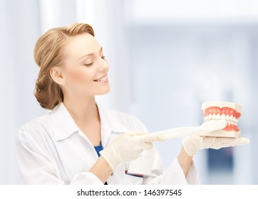 healthcare, medical and stomatology - doctor with toothbrush and jaws in hospital
