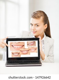 healthcare, medical and stomatology - woman with laptop and smiles