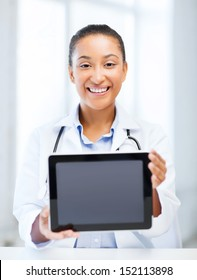 healthcare, medical and technology concept - african female doctor with tablet pc