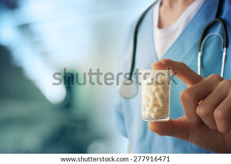Healthcare And Medicine. Close-up of doctor holding a pill container