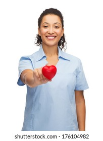 healthcare and medicine concept - smiling female african american doctor or nurse with heart