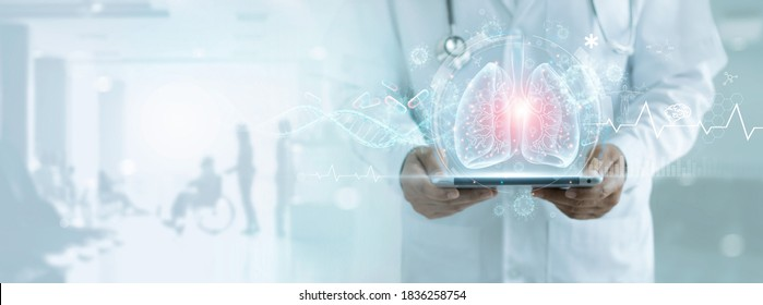 Healthcare and medicine, Covid-19, Doctor holding tablet and diagnose virtual Human Lungs with coronavirus spread inside on modern interface screen on hospital, Innovation and Medical technology.