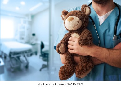 Healthcare And Medicine. Doctor with teddy bear.
