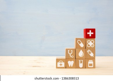 Healthcare and Medicine With Media Icons Concept, Wooden Cube From Stack on wooden table