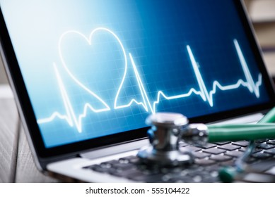 Healthcare online. Stethoscope on laptop keyboard. Computer protection concept