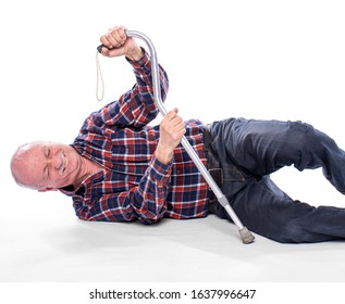 Healthcare, pain, stress and age concept. Senior man fell to the floor and cannot stand up