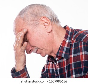 Healthcare, pain, stress and age concept. Sick old man. Senior man suffering from headach over white background. Human emotions, facial expressions, aging, depression
