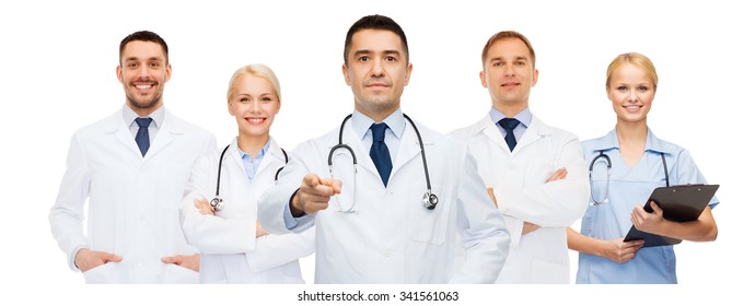 healthcare, profession, gesture, people and medicine concept - group of doctors with stethoscopes and clipboard pointing at you