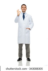 healthcare, profession, gesture, people and medicine concept - smiling male doctor in white coat showing ok hand sign