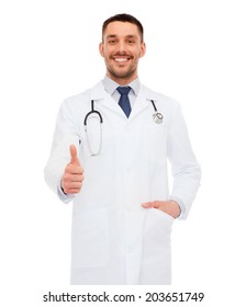 healthcare, profession and medicine concept - smiling male doctor with stethoscope showing thumbs up over white background