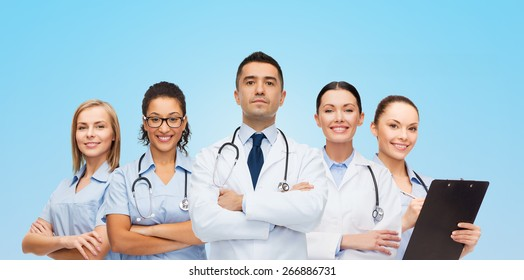 healthcare, profession, people and medicine concept - group of medics with stethoscopes over blue background