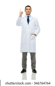 healthcare, profession, people and medicine concept - male doctor in white coat pointing finger up