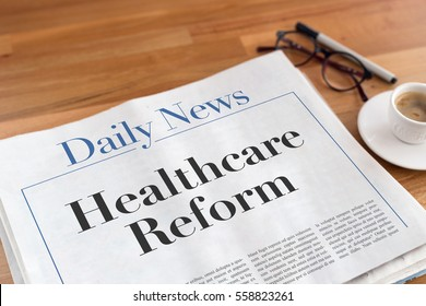 Healthcare Reform headlined newspaper on the table