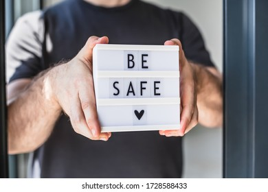 Healthcare and Safety concept. Unrecognised man holding lightbox with text Be safe during coronavirus COVID-19 pandemics