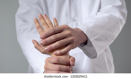 Healthcare specialist examining injured wrist, alternative medicine treatment