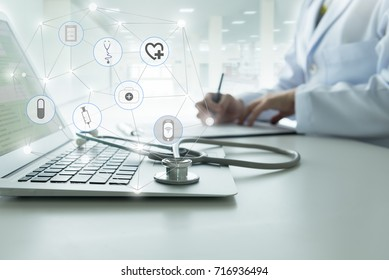 healthcare technology concept. Doctor using a laptop computer contact with patient.