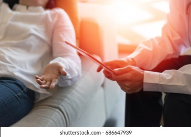 Healthcare technology concept of professional psychologist doctor consult in psychotherapy session or counsel diagnosis health with tablet.