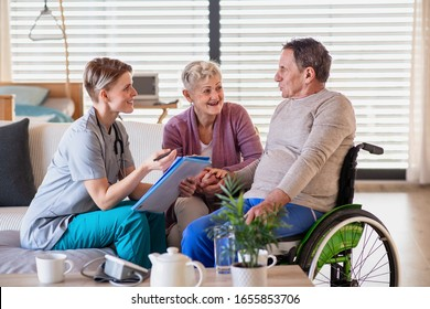 A healthcare worker visiting senior patient in wheelchair at home.