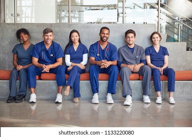 Healthcare workers sitting in a modern hospital, low angle