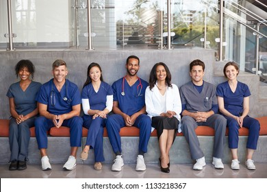 Healthcare workers sitting together in a modern hospital